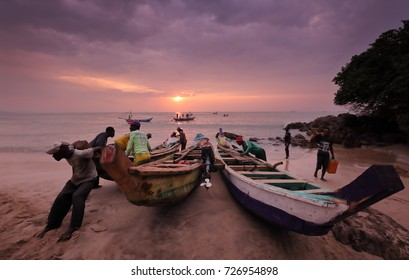 SENYA BERAKU - GHANA - AUGUST 25, 2017: Unidentified fisher launch a boat on August 25, 2017 in Senya Beraku, Ghana. Illegal fishing by foreign vessels threatens traditional fishing villages in Ghana