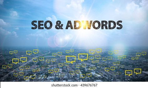 SEO AND ADWORDS text on city and sky background with bubble chat ,business analysis and strategy as concept