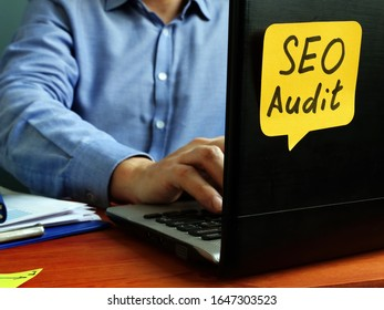 SEO audit concept. Specialist working with laptop.