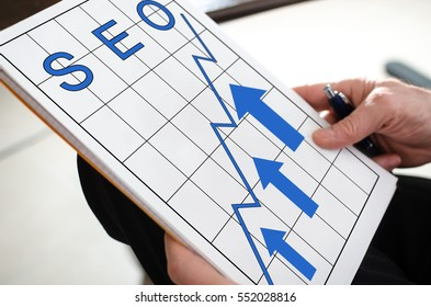 Seo concept on a paper held by a hand