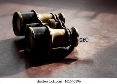 Seo concept with vintage binoculars.