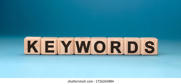 Seo keywords - text concept on wooden cubes with gradient blue background