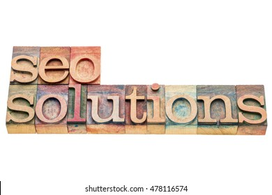 SEO solutions banner in letterpress wood type printing blocks isolated on white