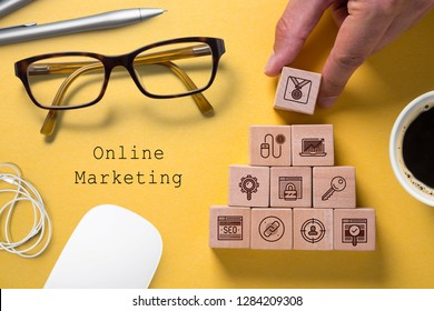 SEO strategy with components for successful marketing as icons on cubes on paper background