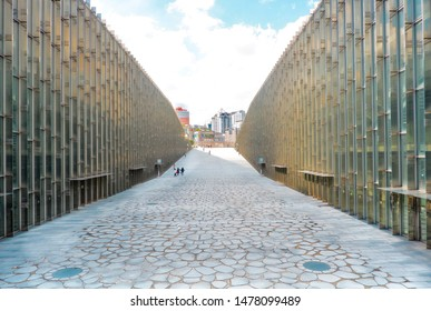 Seodaemun-gu, Seoul / South Korea - October 10, 2018: Ehwa Woman's University campus complex. Perspective view of its famous pathway with people walking. World's largest female educational institute.