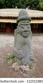 Seogwipo, South Korea - May 30, 2018: There is a large volcanic rock statue known as dol hareubang is found at the courtyard of Seongeup Folk Village in Jeju island.