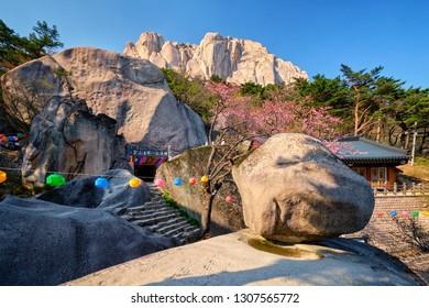 SEORAKSAN, SOUTH KOREA - APRIL 15, 2017: Kyejoam Seokgul Hermitage shrine and Ulsanbawi rock in Seoroksan National park, South Korea