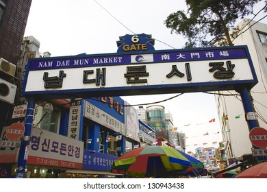 SEOUL - APRIL  21, 2011: Gate No 6 of Nam Dae Mun Market, crowd present. This is the oldest, dates back to 1414, and largest traditional market in South Korea.