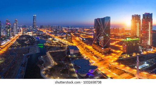 Seoul city with Beautiful after sunset and Skyscraper, Central park in Songdo District, Incheon South Korea.