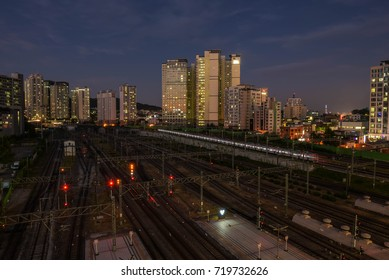 seoul city night view , south korea , 9.20.2017 : yongsan  in seoul city trail on train track, around buildings, yeouido skyline and land mark and susnet