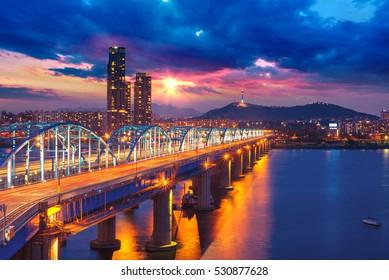 Seoul city skyline at Dongjak Bridge Han river in Seoul , South Korea.