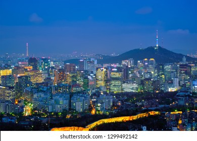 Seoul downtown cityscape illuminated with lights and Namsan Seoul Tower in the evening view from Inwang mountain. Seoul, South Korea.