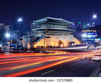 SEOUL - FEBRUARY 13, 2013: Traffic passes Dongdaemun Gate February 13, 2013 in Seoul, KR. The structure dates from 1398 and is one of the The Eight Gates of Seoul.