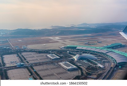 Seoul  Incheon, South Korea, November 2020, aerial view of Seoul  Incheon airport  main terminal during coronavirus pandemic - most of car parking space is empty due to worldwide travel restrictions
