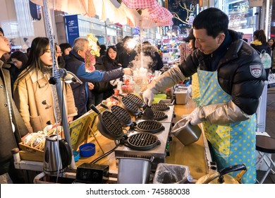 SEOUL - JANUARY 30: Street food on shopping street popular and latest fashion center of Korea on January 30, 2016 at Myeongdong Market in Seoul, South Korea.
