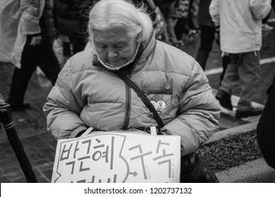Seoul, Korea - 11 26 2018 : Woman at Candlelight Vigil