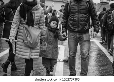 Seoul, Korea - 11 26 2018 : Child at Candlelight Vigil