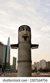 SEOUL, KOREA - 2 DECEMBER 2018: Totem pole based on traditional Korean jangseung at entrance to Olympic Park.  They were placed at village entrances to mark boundaries, greet visitors and scare demons