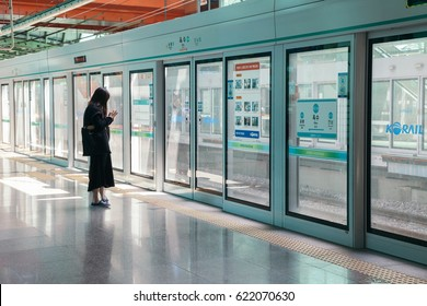 Seoul, Korea - April 10, 2017 : Oksu station platform screen door with passenger