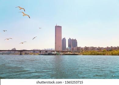 "Seoul, Korea - April 11, 2018: Hangang river and ""63 Building"" on the Yeouido island"