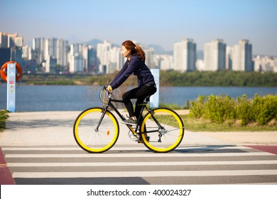 SEOUL, KOREA - APRIL 24, 2015: Young couple cycling at a recreation park zone on the bank of Hangang river in Seoul, Korea