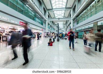 SEOUL, KOREA - APRIL 29, 2015: People walking in Incheon Airport, Seoul; Korea