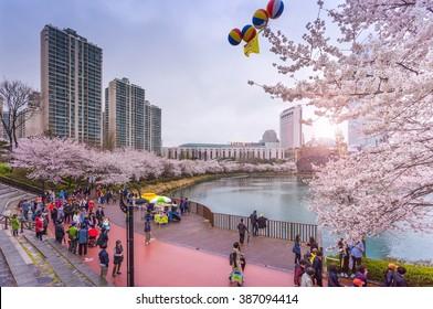 SEOUL, KOREA - APRIL 5, 2015: tourist In spring with cherry blossoms,Lotte World, Amusement park in Seoul South Korea on April 5, 2015