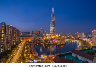 SEOUL, KOREA - APRIL 7, 2019: Cherry Blossom View of Seokchon lake park and Lotte world tower in Seoul, South Korea