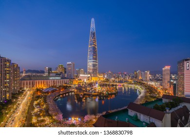 SEOUL, KOREA - APRIL 7, 2019: Cherry Blossom View of Seokchon lake park and Lotte world tower in Seoul, South Korea