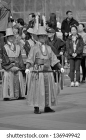 SEOUL KOREA APRIL 7: Participants at the Deoksugung Palace Royal Guard-Changing Ceremony on april 07 2013 in Seoul. Is a tradition similar to the Changing of the Guards at Buckingham Palace
