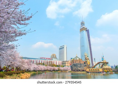 SEOUL, KOREA - APRIL 9, 2015: Lotte World amusement park and cherry blossom of Spring, a major tourist attraction in Seoul, South Korea on April 9, 2015