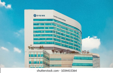 "SEOUL, KOREA - AUGUST 12, 2015: Yonsei Univercity Cancer Center - writing on the building means ""Yonsei Univercity Cancer Hospital"" - high end hospital in Seoul, South Korea"