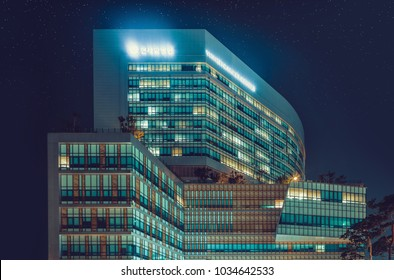 "SEOUL, KOREA - AUGUST 12, 2015: Yonsei Univercity Cancer Center at night - writing on the building means ""Yonsei Univercity Cancer Hospital"" - high end hospital in Seoul, South Korea"