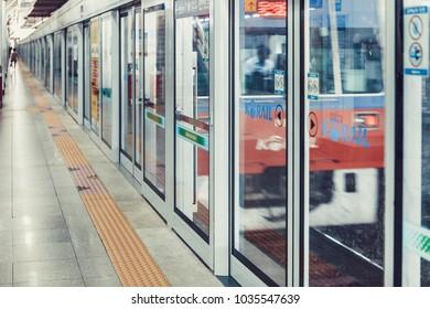 SEOUL, KOREA - AUGUST 12, 2015: Subway train aproaching to an empty platform of Yongsan station - Seoul, South Korea