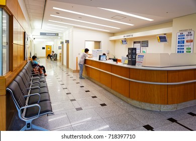 SEOUL, KOREA - AUGUST 12, 2015: One lady waiting at registration desk of Severance hospital of Yonsei University - prestigious high end hospital in Seoul, South Korea