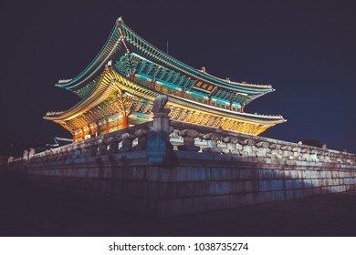 "Seoul, Korea - August 14, 2015: Gyeongbokgung palace at night with writing in chinese meaning - ""diligence helps governance"" - Seoul, Republic of Korea"