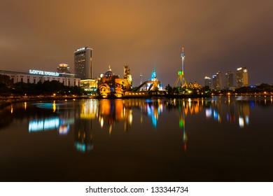 SEOUL, KOREA - AUGUST 26, 2009: The lights of Lotte World, a Korean amusement park and major tourist destination, reflect from the surface of a lake at night in Seoul, South Korea on August 26, 2009