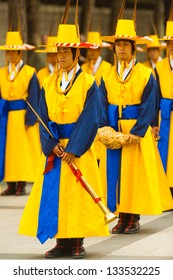 Seoul, Korea - August 27, 2009: Traditional Korean musicians in yellow period costume wait in formation at Deoksugung Palace for changing of the guards ceremony