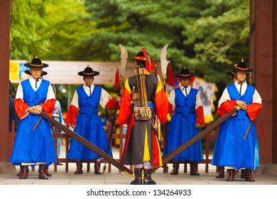 Seoul, Korea - August 27, 2009: Armed soldiers in blue, brown colorful period costume guard the entrance gate into Deoksugung Palace
