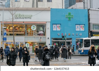 Seoul, Korea – December 13, 2018 : People walking on the street and tolerate the cold while traveling to work in Seoul, South Korea.