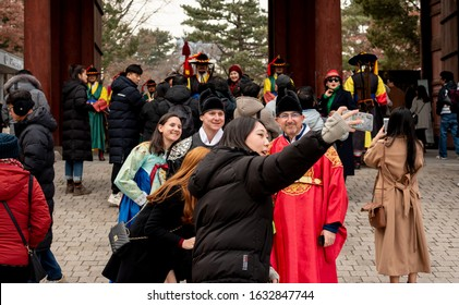 Seoul korea December 25,12 2019. Deoksugung Palace's Daehanmun Gate. The tourists experienced Palace Royal Guard-Changing Ceremony. Deoksugung is Seoul tourist landmark.
