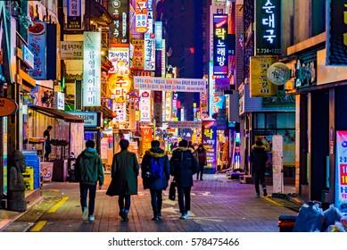 SEOUL, KOREA - DECEMBER 31, 2016 -    Colorful billboards on the street of Seoul at night.