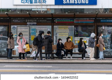 Seoul, Korea - Feb 23, 2020 : New type coronavirus 2019-nCoV pneumonia in Wuhan has been spreading into many cities around the world. People wearing masks at bus stops.