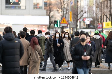 Seoul, Korea - Feb 23, 2020 : New type coronavirus 2019-nCoV pneumonia in Wuhan has been spreading into many cities around the world. People wearing masks on a crossboard.
