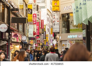 SEOUL, KOREA - FEBRUARY 25, 2015 : People at Myeong-Dong in sunlight.The location is the premiere district for shopping in the city.