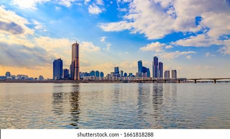 SEOUL, KOREA - January 30, 2020. Han River Railway Bridge and Yeouido 63 Building in Seoul. Seoul Korail Subway Service.