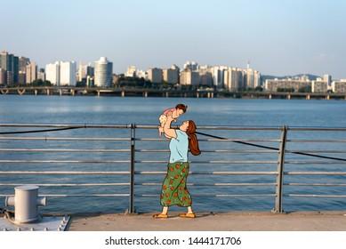 SEOUL KOREA - JULY 2, 2019. Hangang Park summer view. Mom and Baby cartoon sculpture in hangang river park.