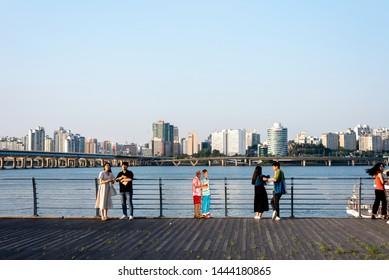 SEOUL KOREA - JULY 2, 2019. Hangang Park summer view. people cartoon sculpture in hangang river park.