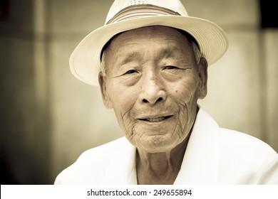 Seoul, Korea - July 2012. An elderly Korean man is in pagoda park in Seoul, Korea in July 2012.