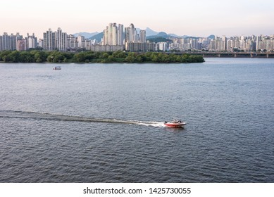 SEOUL KOREA - JUN  2, 2019.  Hangang  River Park summer view. Person are playing a motorboat in the  Hangang river.